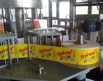 Етикираща машина за РР обиколен етикет от ролка